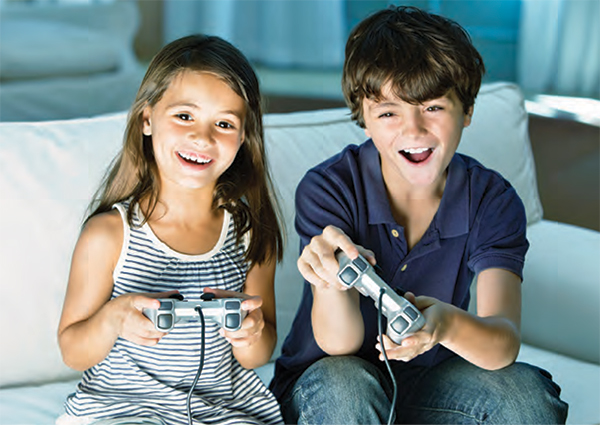 Children playing on a game console