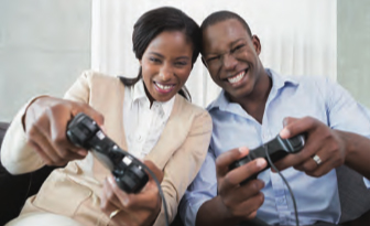 Couple playing a console game